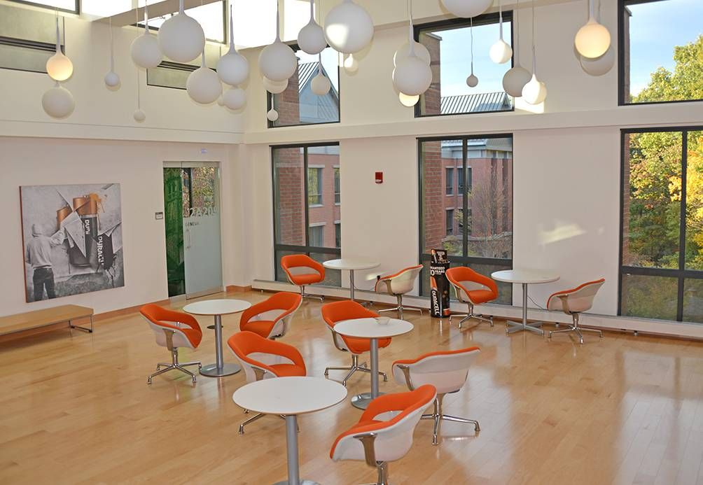 Modern office with orange chairs
